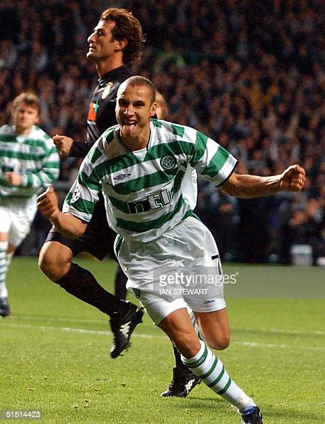 Celtic Glasgow's Swedish striker Hendrik Larsson celebrates after scoring from the penalty spot against Juventus Turin during the UEFA Champions...