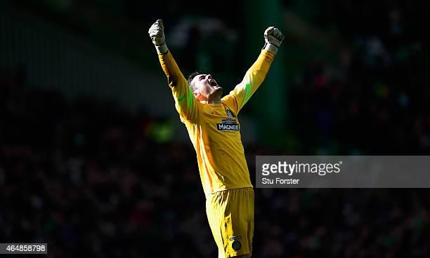 Celtic goalkeeper Craig Gordon celebrates the third Celtic goal during the Scottish Premiership match between Celtic and Aberdeen at Celtic Park...