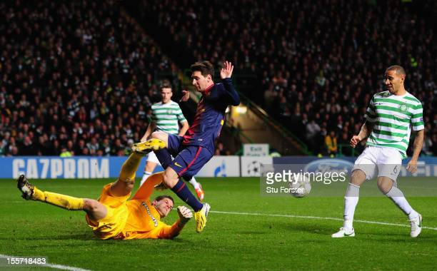 Celtic goalkeeper Fraser Forster denys Barcelona player Lionel Messi during the UEFA Champions League Group G match between Celtic and Barcelona at...
