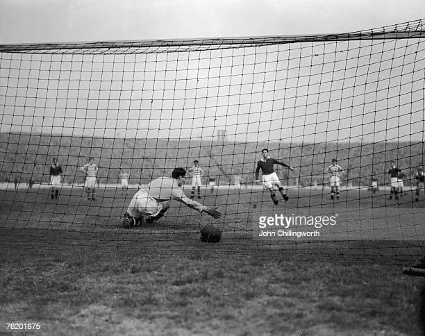 Celtic goalkeeper Miller fails to keep the ball out of the net after a penalty kick by William Waddell of Rangers at Ibrox Stadium, Glasgow, 15th...