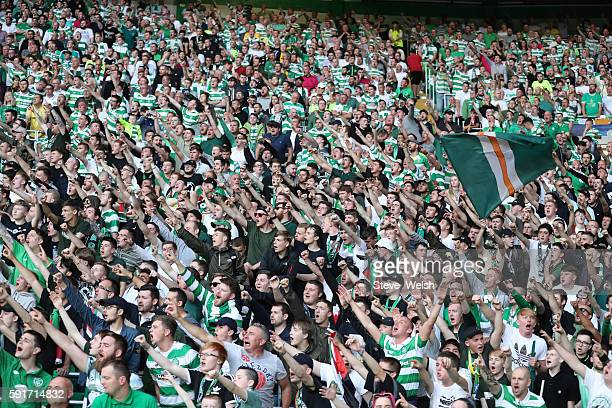 Celtic Green Brigade fans during the UEFA Champions League, Qualifying Play-Off 1st Leg between Celtic and Hapoel Be'er Sheva at Celtic Park on...