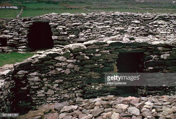 Celtic iron age promontary fort on the Dingle peninsula from inside the fort showing the inner and outer defensive wals with gateways The walls are...