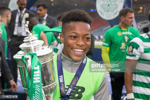 Celtic Karamoko Dembele poses with the trophy after the William Hill Scottish Cup Final at Hampden Park, Glasgow.