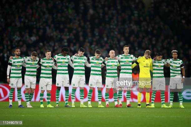 Celtic line up for a minute's silence for Emiliano Sala during the UEFA Europa League Round of 32 First Leg match between Celtic and Valencia at...