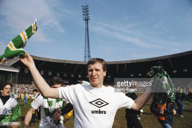 Celtic manager Billy McNeill celebrates after Celtic had beaten Dundee 30 to win the 1987/88 Scottish League Title at Park Head on April 23 1988 in...
