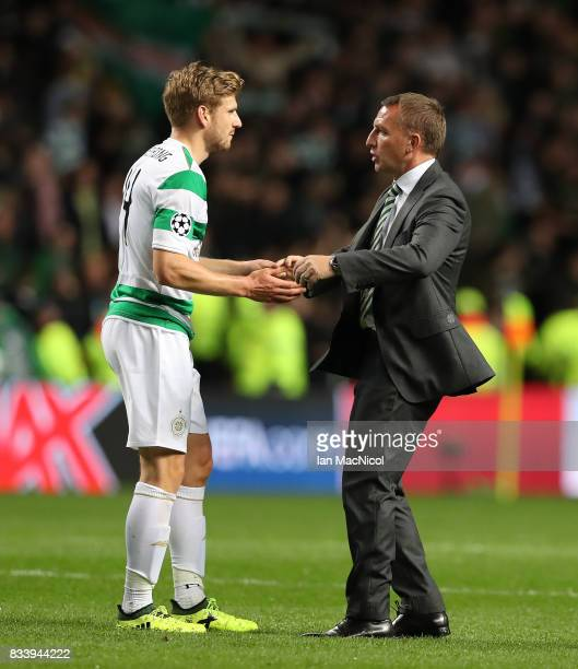 Celtic manager Brendan Rodgers and Stuart Armstrong of Celtic are seen during the UEFA Champions League Qualifying PlayOffs Round First Leg match...