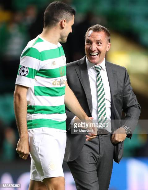 Celtic manager Brendan Rodgers celebrates at full time with Tomas Rogic of Celtic during the UEFA Champions League Qualifying PlayOffs Round First...