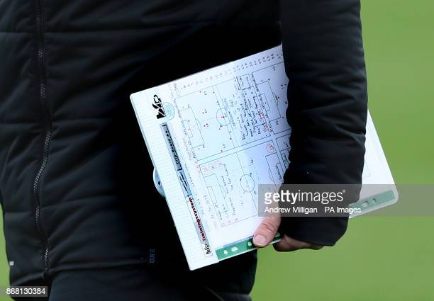 Celtic manager Brendan Rodgers holds a tactic board during the training session at Lennoxtown Glasgow