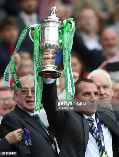 Celtic Manager Brendan Rodgers lifts the trophy during the William Hill Scottish Cup Final between Celtic and Aberdeen at Hampden Park on May 27,...