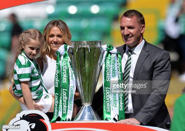 Celtic manager Brendan Rodgers poses with his wife Charlotte and their daughter Lola as they celebrate Celtic winning the Ladbrokes Scottish Premier...