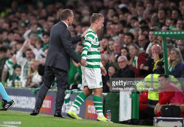 Celtic manager Brendan Rodgers shakes hands with Leigh Griffiths as he is substituted during the UEFA Europa League PlayOff Second Leg match at...
