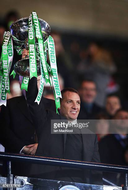 Celtic manager Brendan Rogers lifts the trophy during the Betfred Cup Final between Aberdeen and Celtic at Hampden Park on November 27 2016 in...
