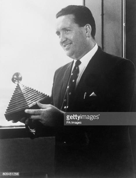 Celtic Manager Jock Stein holding the Manager of the Year 196566 Trophy