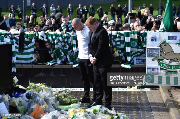 Celtic manager Neil Lennon and captain Scott Brown lay a wreath at the Billy McNeill statue before the Ladbrokes Scottish Premiership match at Celtic...