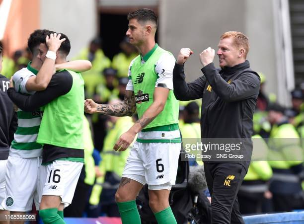 Celtic manager Neil Lennon celebrates his side's second goal during the Ladbrokes Premier match between Rangers and Celtic at Ibrox Stadium, on...