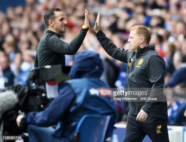 Celtic manager Neil Lennon celebrates the opener with assistant John Kennedy during the Ladbrokes Premier match between Rangers and Celtic at Ibrox...