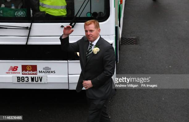 Celtic manager Neil Lennon exits the bus after winning the William Hill Scottish Cup during the trophy parade through Glasgow