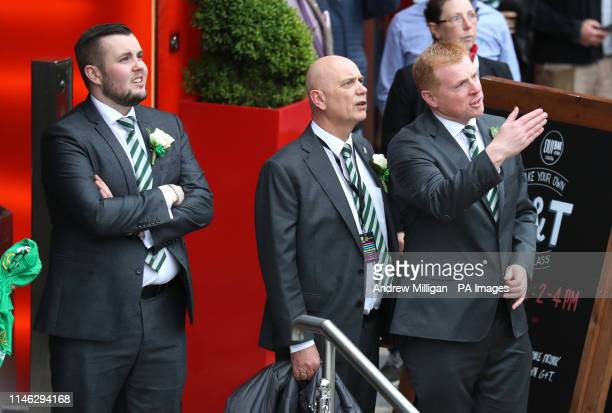 Celtic manager Neil Lennon instructs players to get off the bus during the trophy parade through Glasgow