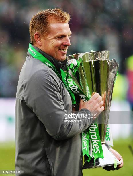 Celtic manager Neil Lennon is seen with the trophy during the Scottish Premier league match between Celtic and Hearts at Celtic Park on May 19 2019...