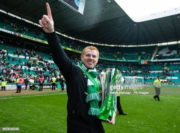 Celtic manager Neil Lennon parades the SPL trophy on the pitch after the Clydesdale Bank Premier League match at Celtic Park Glasgow