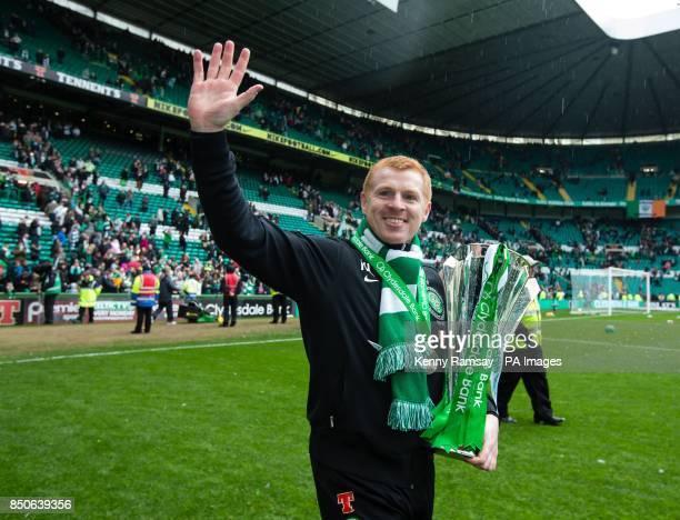 Celtic manager Neil Lennon parades the SPL trophy on the pitch after the Clydesdale Bank Premier League match at Celtic Park Glasgow