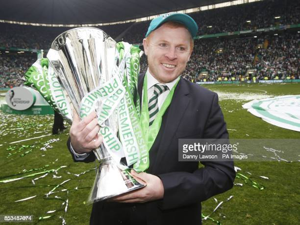 Celtic Manager Neil Lennon poses with the trophy following the Scottish Premiership match at Celtic Park Glasgow