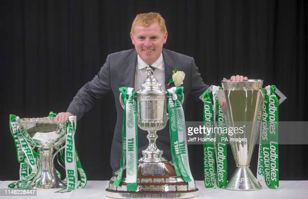 Celtic Manager Neil Lennon with the Treble of Scottish trophies during the William Hill Scottish Cup Final at Hampden Park Glasgow