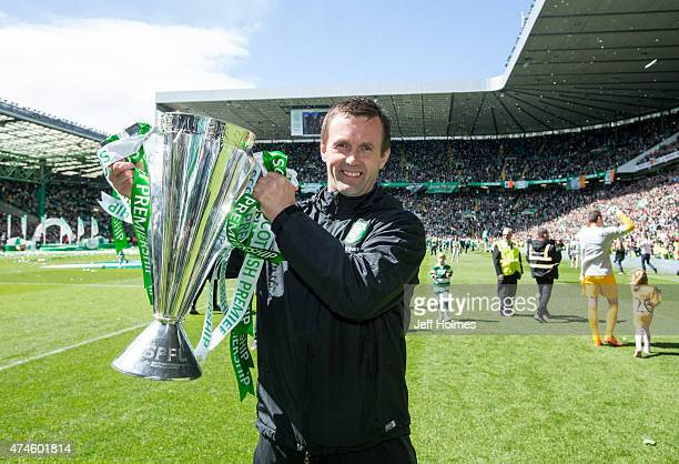 Celtic manager Ronny Deila lifts the trophy after the Scottish Premiership Match between Celtic and Inverness Caley Thistle at Celtic Park on May 24...