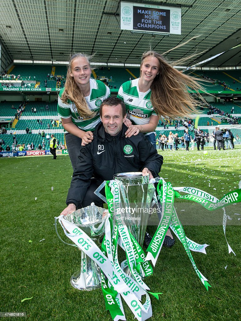 Celtic manager Ronny Deila with daughters Thale and Lave and both cups he has won this season after the Scottish Premiership Match between Celtic and Inverness Caley Thistle at Celtic Park on May 24, 2015 in Glasgow, Scotland.