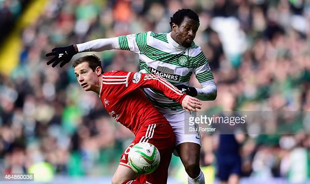 Celtic player Efe Ambrose is challenged by Peter Pawlett of Aberdeen during the Scottish Premiership match between Celtic and Aberdeen at Celtic Park...