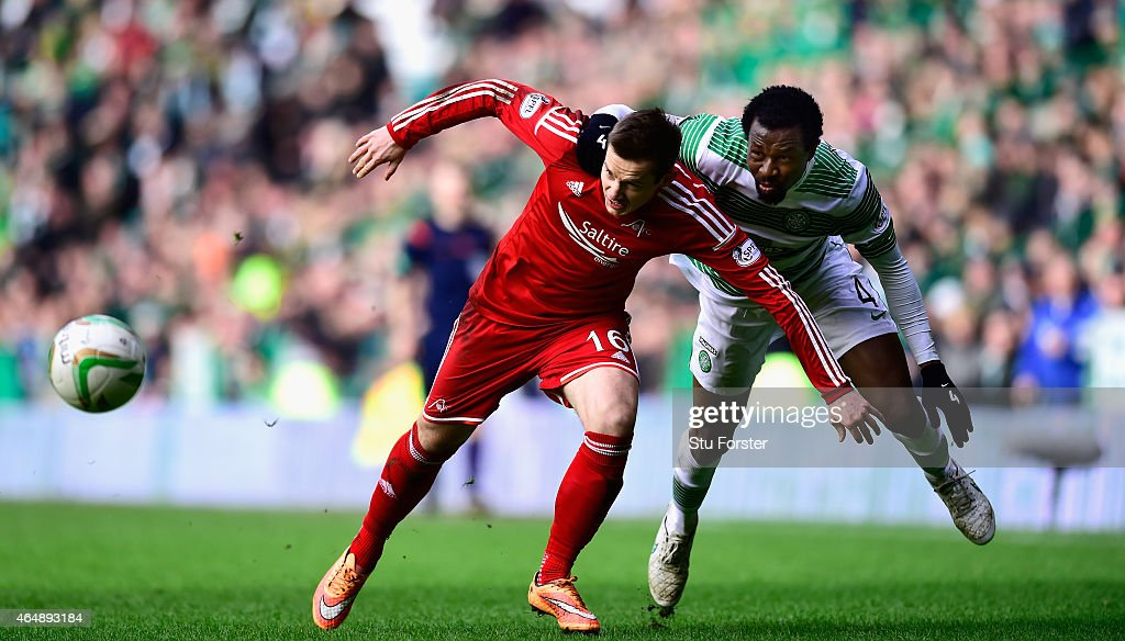 Celtic player Efe Ambrose (r) is challenged by Peter Pawlett of Aberdeen during the Scottish Premiership match between Celtic and Aberdeen at Celtic Park Stadium on March 1, 2015 in Glasgow, Scotland.