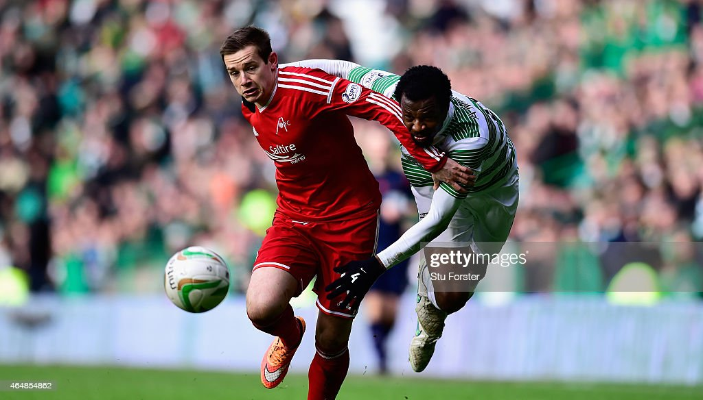 Celtic player Efe Ambrose (r) is challenged by Peter Pawlett of Aberdeenl during the Scottish Premiership match between Celtic and Aberdeen at Celtic Park Stadium on March 1, 2015 in Glasgow, Scotland.