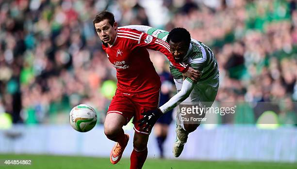 Celtic player Efe Ambrose is challenged by Peter Pawlett of Aberdeenl during the Scottish Premiership match between Celtic and Aberdeen at Celtic...