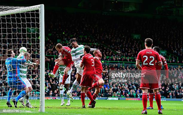 Celtic player Jason Denayer heads the opening goal during the Scottish Premiership match between Celtic and Aberdeen at Celtic Park Stadium on March...