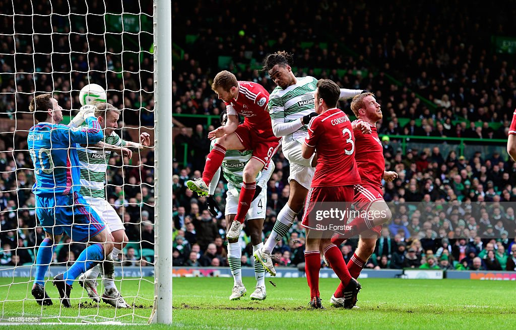 Celtic player Jason Denayer (c) heads the opening goal during the Scottish Premiership match between Celtic and Aberdeen at Celtic Park Stadium on March 1, 2015 in Glasgow, Scotland.