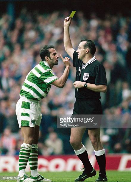 Celtic player Paolo Di Canio wags a finger at the referee after being booked during an Old Firm game at Ibrox on September 28 1996 in Glasgow Scotland
