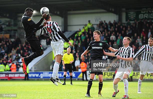 Celtic player Victor Wanyama rises above Steven Thompson to get in a header during the Clydesdale Bank Scottish Premier League match between St...