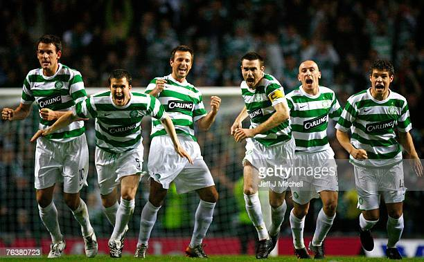 Celtic players celebrate after beating Spartak Moscow in extra time and penalties during the Champions League third round qualifier second leg match...