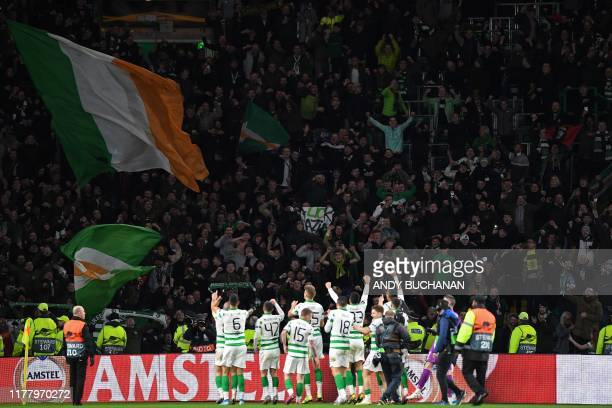 Celtic players celebrate after winning the UEFA Europa League group E football match between Celtic and Lazio at Celtic Park stadium in Glasgow...