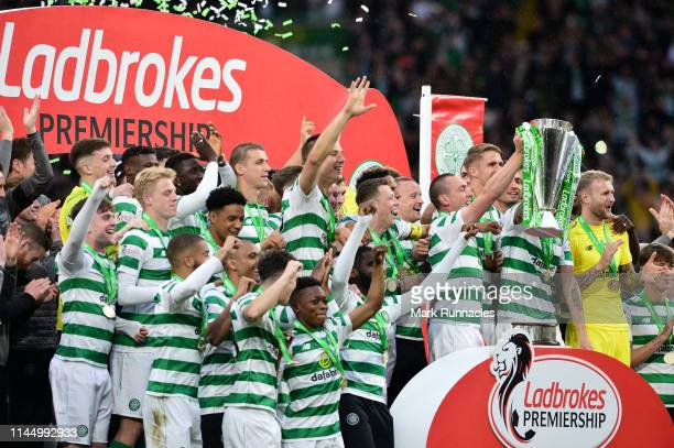 Celtic players celebrate as club captain Scott Brown lifts the trophy during the Ladbrokes Scottish Premiership match between Celtic FC and Heart of...