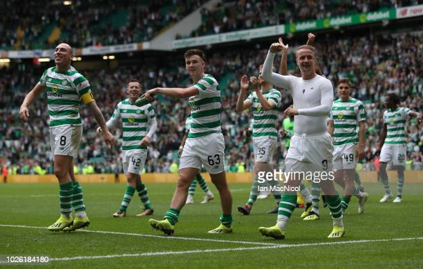 Celtic players celebrate at full time during the Scottish Premier League between Celtic and Rangers at Celtic Park Stadium on September 2 2018 in...