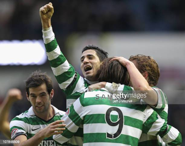 Celtic players celebrate at the end of the Clydesdale Bank Premier League match between Rangers and Celtic at Ibrox Stadium on January 2, 2011 in...