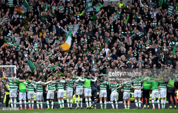 Celtic players celebrate at the final whistle after beating rangers 51 during the Ladbrokes Scottish Premiership match between Rangers FC and Celtic...