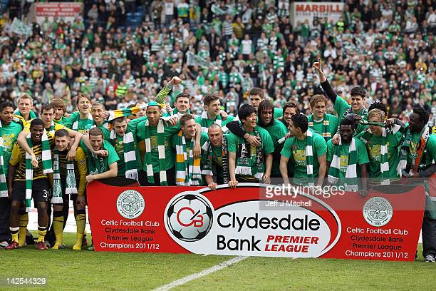 Celtic players celebrate following clinching the Scottish Clydesdale Bank Scottish Premier League title after the match between Kilmarnock and Celtic...