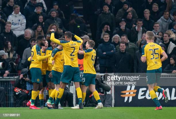 Celtic players celebrate scoring the opening goal during the Europa League last 32 first leg football match between FC Copenhagen and Celtic in...