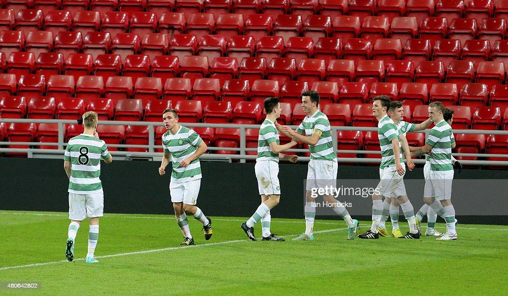 Celtic players celebrate the first Celtic goal during The Premier League International Cup match between Sunderland U21 v Celtic U21 at the Stadium of Light on December 18, 2014 in Sunderland, England.