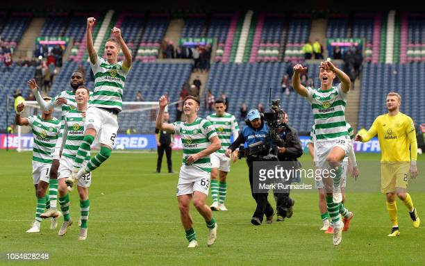 Celtic players celebrate victory after the final whistle of the Betfred Scottish League Cup Semi Final between Heart of Midlothian FC and Celtic FC...
