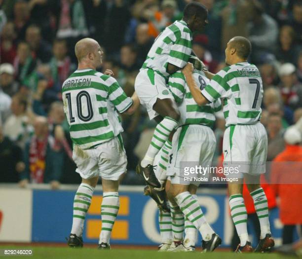 Celtic players congratulate Alan Thompson after his goal gave them the lead against Liverpool during their UEFA cup quarter final second leg at...