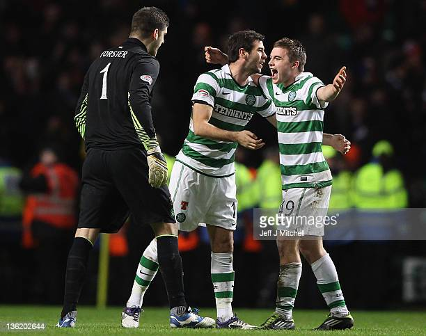 Celtic players Fraser Foster Joe Ledley and James Forrest celebrate at the end of the Clydesdale Bank Premier League match between Celtic and Rangers...