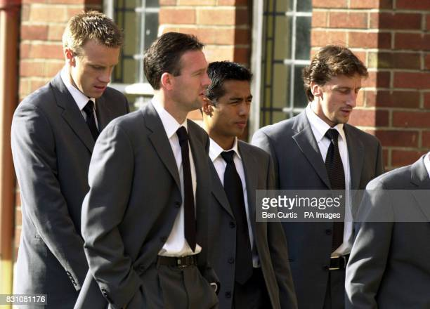Celtic players from left to right Joos Valgaeran Paul Lambert Bobby Petta and Stephan Mahe arrive at St Columbkille's in Rutherglen Glasgow *where...